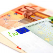 A few euro bills on a white background — Stock Photo