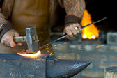 A blacksmith at the work — Stock Photo