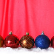 Christmas balls against red background — Stock Photo