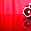 Christmas ball against red background — Stock Photo #1023499