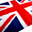 Flapping flag UK with wave — Stock Photo