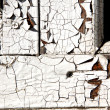 Stock Photo: Erosion of paint at old window