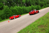 Red sport cars in action — Stock Photo