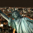 Statue of Liberty against a nighttime Ne — Stock Photo