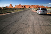 Car in the Road in the desert, Arches Na — Stock Photo