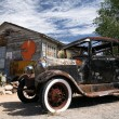 Old american ford beside vintage house — Stock Photo