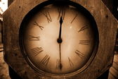 Old clock face shot in Sepia — Stock Photo