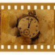 Old 35mm frame photo with vintage clock — Stock Photo