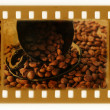 Vintage film ws cup and grain of coffee — Stock Photo