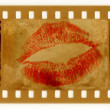 Old 35mm frame photo with red lips — Stock Photo