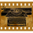 Oldies photo with vintage typewriter - Stock Photo