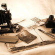 Vintage paper with old books, camera - Stock Photo
