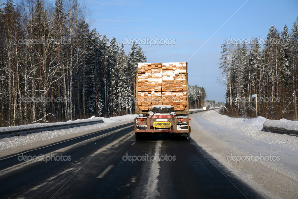 Driving down road in snowy forest — Stock Photo #1331427