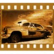Stock Photo: Oldies 35mm frame photo with old car
