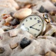 Vintage Watch in the sand with seashell — Stock Photo