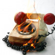Burning vintage phone — Stock Photo