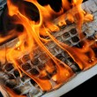 Burning computer keyboard — Stock Photo
