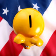 Piggy bank on an American flag — Stock Photo