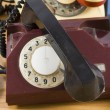 Old telephone with rotary dial - Stock Photo