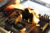 Burning computer board — Stock Photo