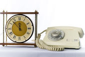 Vintage telephone and old analoque clock — Stock Photo
