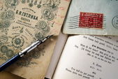 Vintage letters and ink feather — Stock Photo