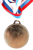 Blank gold medal with three-color ribbon — Stock Photo