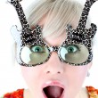 Sirprised girl in funny glasses — Stock fotografie