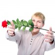 Man with red flower — Stock Photo