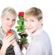 Couple with gift and flower isolated on white — Stock Photo