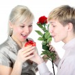 Couple with gift and flower — Stock Photo