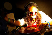 Afro american DJ under yellow-red — Stock Photo