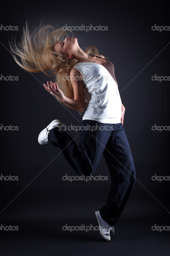 Woman modern dancer against black background  Stock Photo #2029802