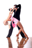Dancers in ballroom — Stock Photo
