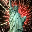 Statue of Liberty and fireworks - Stock Photo