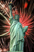 Statue of Liberty and fireworks — Stock Photo