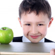 Stock Photo: Schoolboy with book and apple