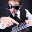 Boy with calculator — Stock Photo