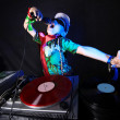 Cool kid DJ in action - Stock Photo
