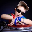 Stock Photo: Cool kid DJ in action