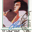 Foto Stock: Stamp with famous singer Elvis Presley