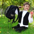 Stock Photo: Schoolboy with backpack and apple