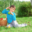 Little boy posing outdoors with apples — Stock Photo #2238792