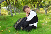 Schoolboy with backpack outdoors — Stock Photo