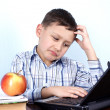 Stock Photo: Thinking boy at PC