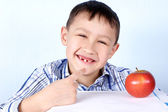 Happy boy with apple — Stock Photo