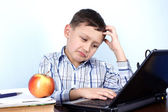 Thinking boy at PC — Stock Photo