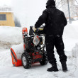 Snowblower in city under snowfall — Stock Photo #2304563