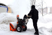 Snowblower in city under snowfall — Stock Photo