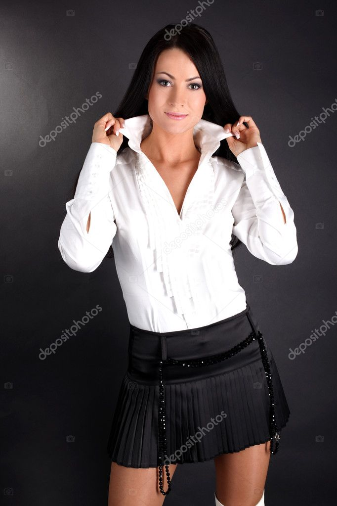 Woman In White Shirt And Black Skirt Stock Photo